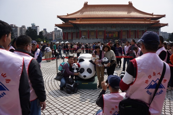 You can hold some of the pandas and take pictures with them.  There must have been over a hundred people in line for this.