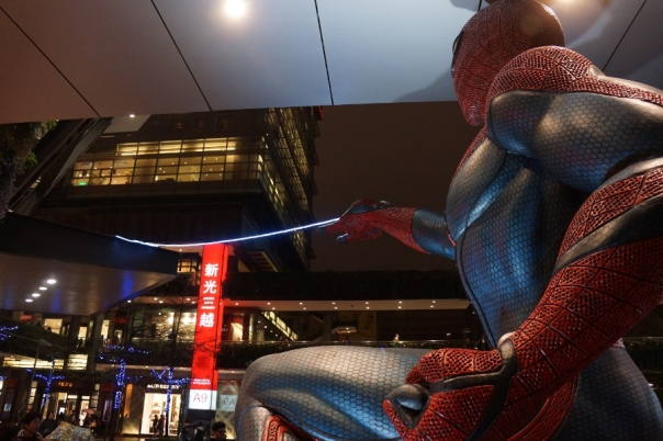 Spider-Man getting ready to swing through Taipei's Shin Kong Mitsukoshi department store.
