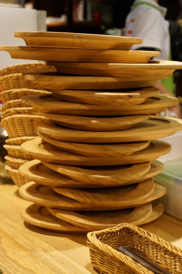 Bread plates stack up near the kitchen.