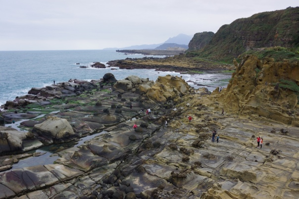 Walk among some interesting rock formations on the coast at Heping Island Park 和平島公園.