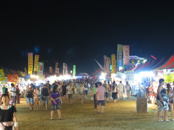 A shot of the food stalls at night.