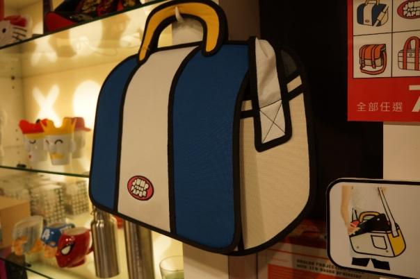 A close up of a blue shoulder bag.  The inside doesn't hide any quirky designs.