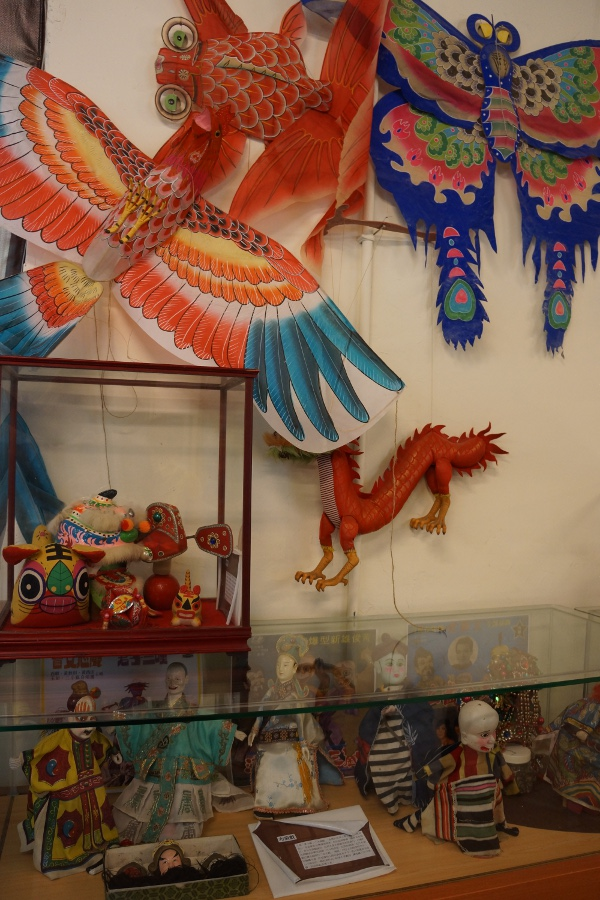 Different Chinese toys, including some stylish kites.