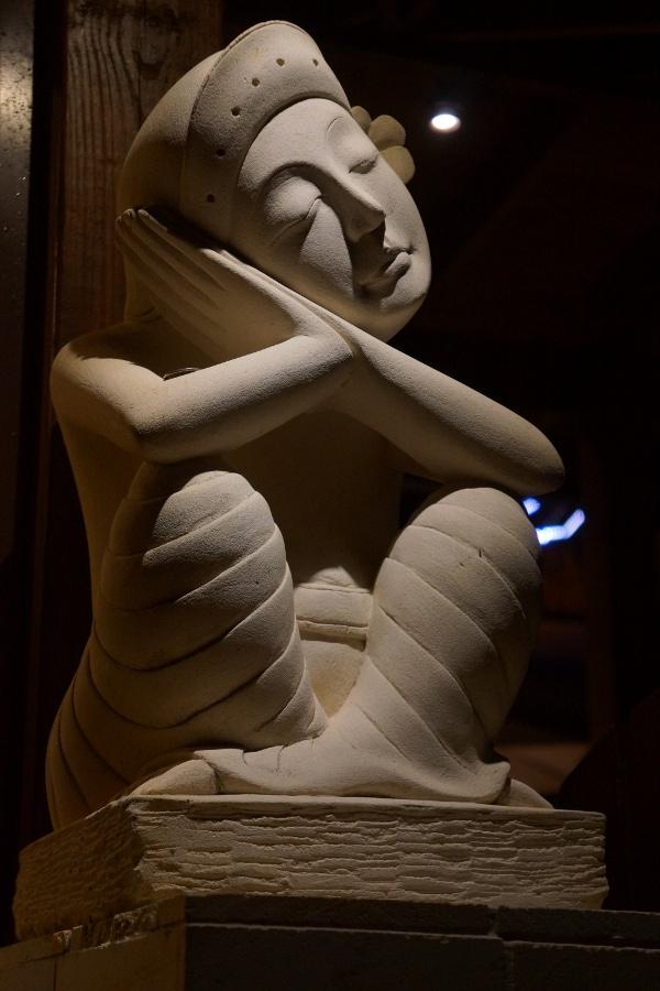 A sleepy statue.