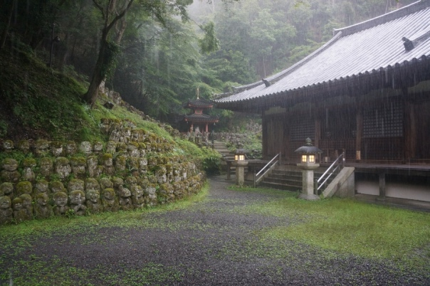 Heavy rains pound a temple in Kyoto.