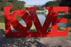 "Try to take a photo in front of every red ""LOVE"" sign in Taiwan."